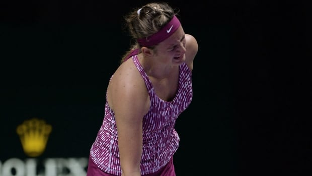 Victoria Azarenka reacts as she leaves the game after suffering a back injury while serving in the sixth game of the first set against Li Na on Friday at the WTA Championships. Li won 6-2, 6-1 to earn a place in the semifinals.