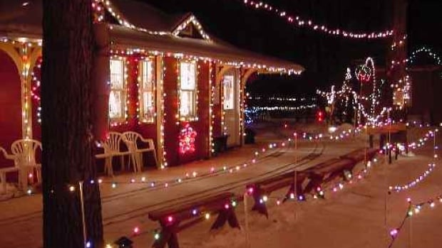 The Assiniboine Valley Railway station in Bill Taylor's yard, ready to welcome guests for a Christmas run. The lights and trains will be absent this year after Taylor died in August.