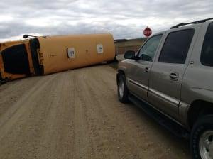 School bus on its side