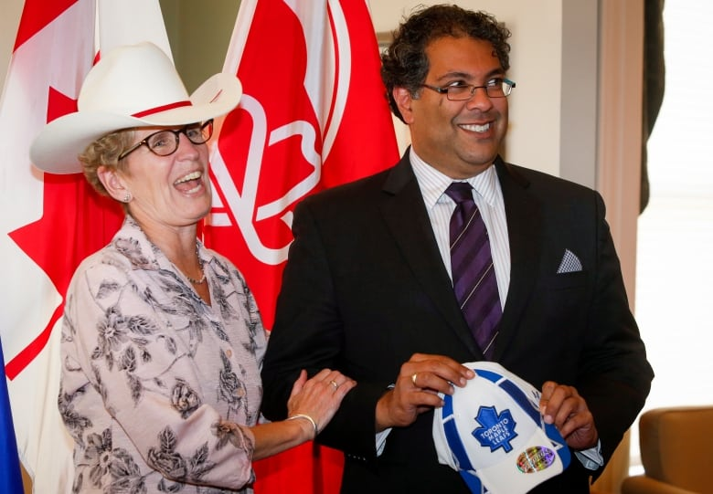 4b83d6fdc3448 Calgary Mayor Naheed Nenshi accepts a Toronto Maple Leafs hat presented by  Ontario Premier Kathleen Wynne after she accepted a ceremonial White Hat in  2013.