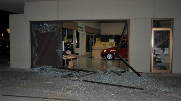 RCMP found a showroom glass bay door smashed, and an empty spot on the floor, at the Penticton Huber GMC dealership after a call came in at 11:26 p.m. PT Thursday night.