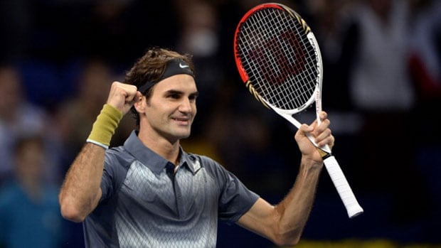 National legend Roger Federer celebrates after winning his semifinal match against Canada's Vasek Pospisil at the Swiss Indoors ATP tournament in Basel, Switzerland Saturday.