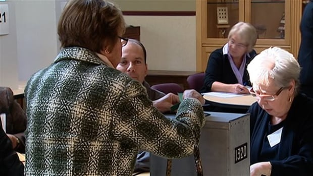 A Montrealer casts her ballot on last Friday's advance voting day.