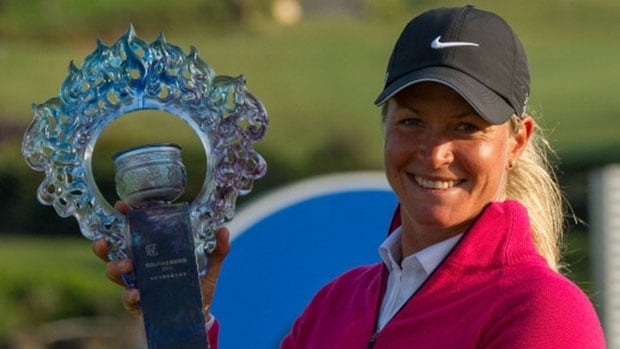 Norwegian Suzann Pettersen poses for the cameras after winning the 2013 Sunrise LPG Taiwan Championship on Sunday in Yangmei, Taiwan.