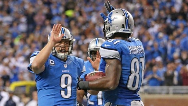 Lions quarterback Matthew Stafford, left, and receiver Calvin Johnson (81) combined to shock the Dallas Cowboys after a last-second win Sunday in Detroit. Leon Halip/Getty Images