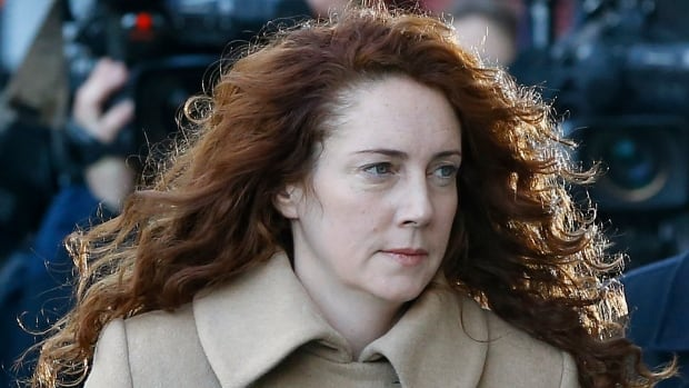 Former News of the World newspaper editor Rebekah Brooks arrives at the Old Bailey law court in London Monday. She and her former colleague Andy Coulson go on trial today, along with several others, on charges of hacking phones and bribing officials while at the now-closed tabloid paper.