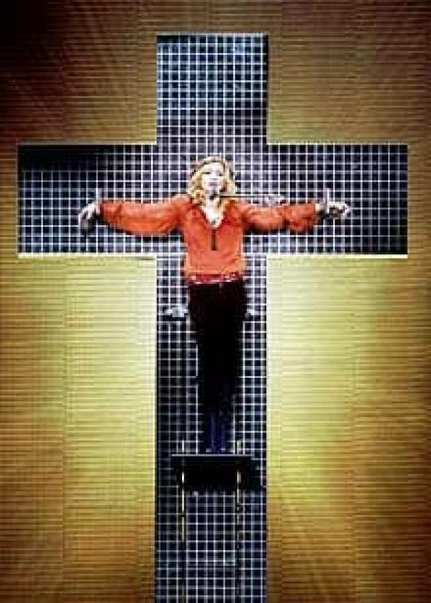 germans ponder legal action over madonna 39 s crucifixion stunt entertainment cbc news. Black Bedroom Furniture Sets. Home Design Ideas
