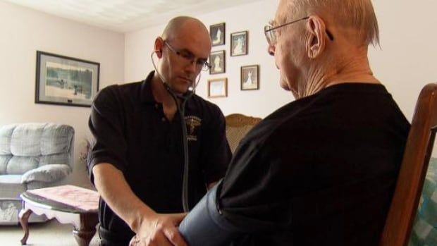 Deep River, Ont. paramedic Chris Day regularly stops by Wilt McCarthy's home to do a basic health check.