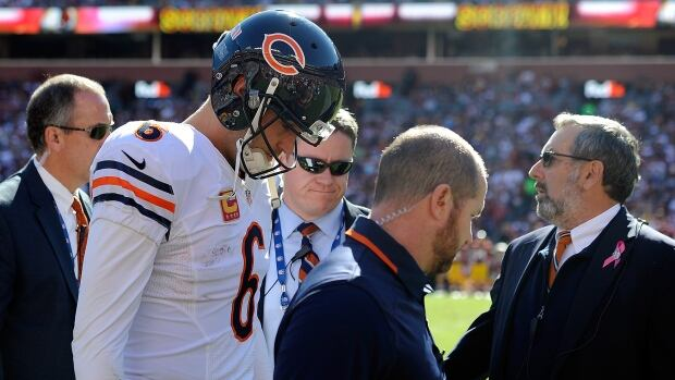 Quarterback Jay Cutler of the Chicago Bears walks off the field after suffering a groin injury on a play against the Washington Redskins in the second quarter during an NFL game at FedExField on October 20, 2013 in Landover, Maryland.