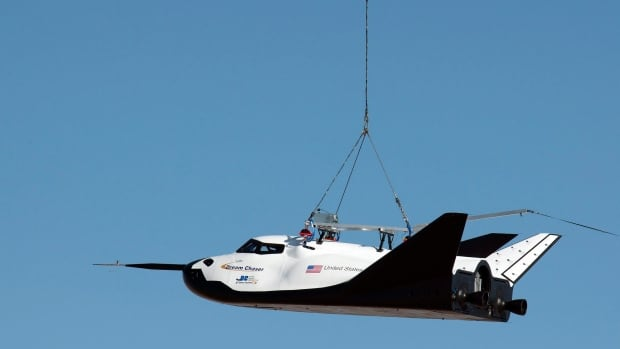 A helicopter dropped the unmanned Dream Chaser space shuttle from 3,810 metres on Saturday. It had undergone a previous test in August, shown in the photo, in which it was carried by a helicopter.