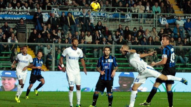 Atalanta's German Denis, right, scores against Inter Milan in Bergamo, Italy, on Tuesday.