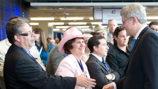 Prime Minister Stephen Harper is greeted by delegates at the 2011 Conservative convention in Ottawa.