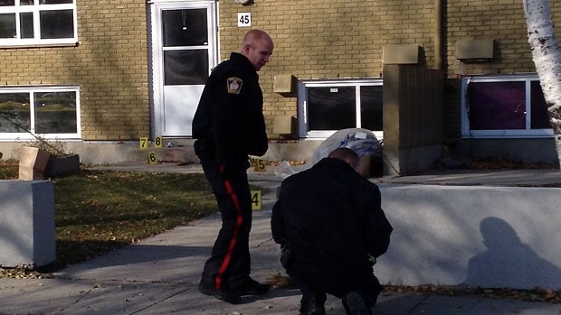 Winnipeg police investigate in the 400 block of King Street on Wednesday, after a man's body was discovered at the location.