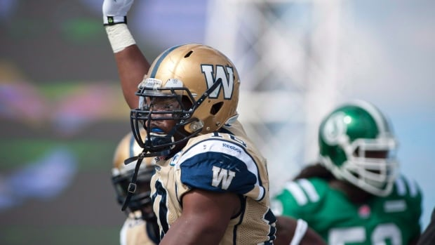 Winnipeg Blue Bombers linebacker Henoc Muamba celebrates a tackle against the Saskatchewan Roughriders on Sept. 1, 2013. The team announced Wednesday that it has released Muamba so he can pursue opportunities in the NFL.