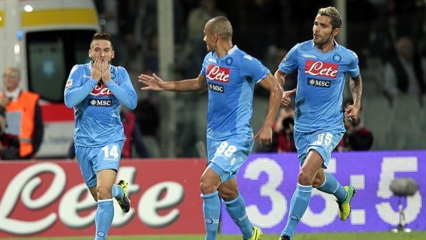 Napoli players celebrate after a goal against Fiorentina at Stadio Artemio Franchi on October 30, 2013 in Florence, Italy.