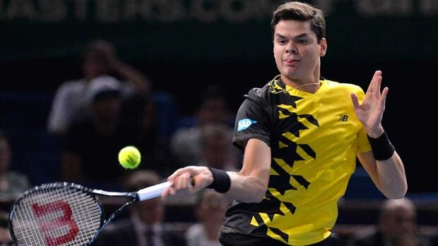 Canada's Milos Raonic returns a shot to Netherland's Robin Haase during their second-round match at the final ATP World Tour Masters 1000 indoor tennis tournament on Wednesday in Paris.