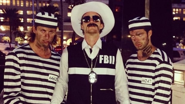 The Florida Panthers were among several teams that saw their players dress up for Halloween, including their star forward Jonathan Huberdeau, centre, who is seen here as a law enforcement official.