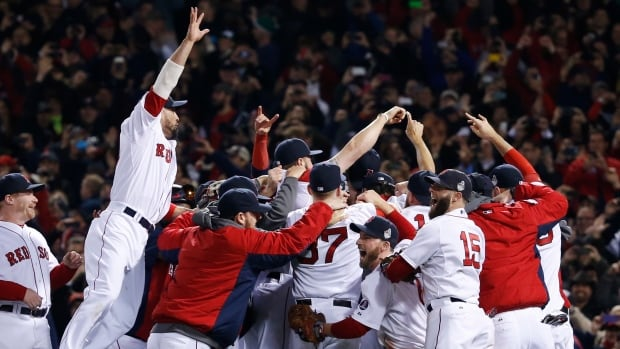 Boston Red Sox players celebrate after defeating the St. Louis Cardinals 6-1 in Game 6 of the World Series on Wednesday.