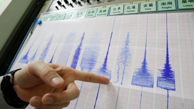 An official points to strong earthquake markings on seismogram recordings at the Seismology Centre in Taipei, Taiwan. The U.S. Geological Survey said the earthquake struck at 8:02 p.m. and measured magnitude 6.3.