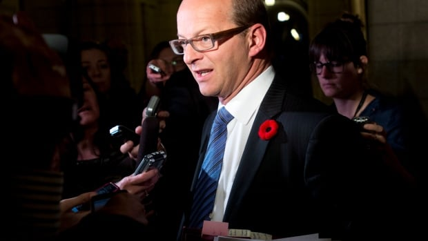 Leader of the Government in the Senate, Sen. Claude Carignan speaks with the media about a new motion to suspend Mike Duffy, Pamela Wallin and Patrick Brazeau without pay. However the three senators would be allowed to keep their health benefits.