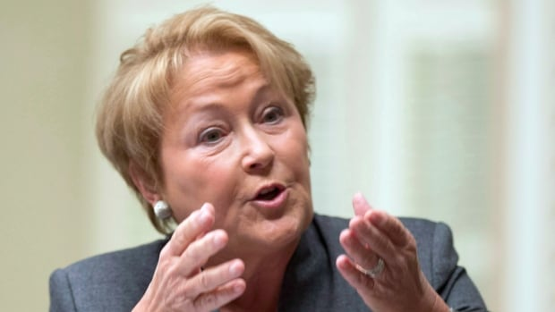 Quebec Premier Pauline Marois defends her government over the Alcoa lobby to reduce prices for electricity Wednesday, October 30, 2013 at the legislature in Quebec City.
