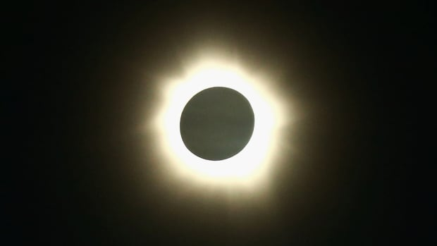 A hybrid solar eclipse is an unusual eclipse that morphs between a total eclipse – in which the moon completely blots out the sun – and an annular eclipse, in which a ring of sunlight is still visible around the moon.