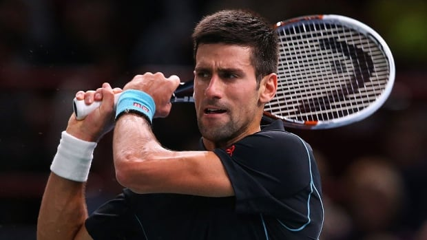 Novak Djokovic, pictured here, defeated Stanislas Wawrinka of Switzerland 6-1, 6-4 at the Paris Masters on Friday to set up a semifinal matchup with Roger Federer.