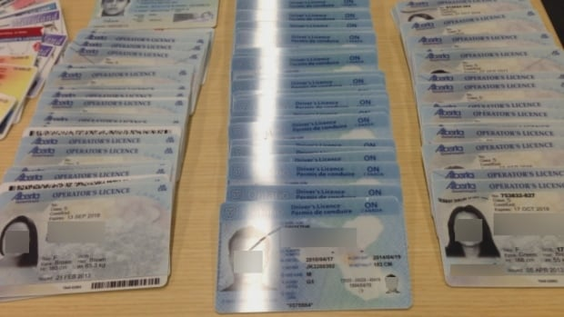 Three men are facing charges after police busted a half-million-dollar business selling fake identification online to people across Canada and the U.S., Metro Vancouver Transit Police say. (Transit Police)