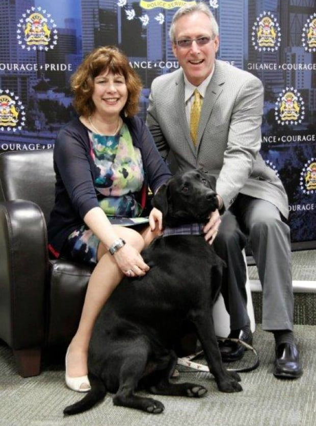 Mack the dog with owners