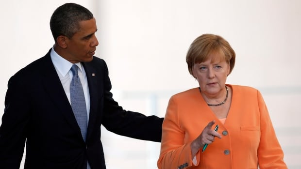 President Barack Obama and German Chancellor Angela Merkel arrive for a news conference at the chancellery in Berlin in June, before the Edward Snowden leaks suggested that the NSA has been monitoring her communications.