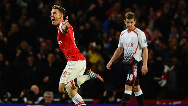 Aaron Ramsey of Arsenal celebrates his goal against Liverpool at Emirates Stadium on November 2, 2013 in London, England.
