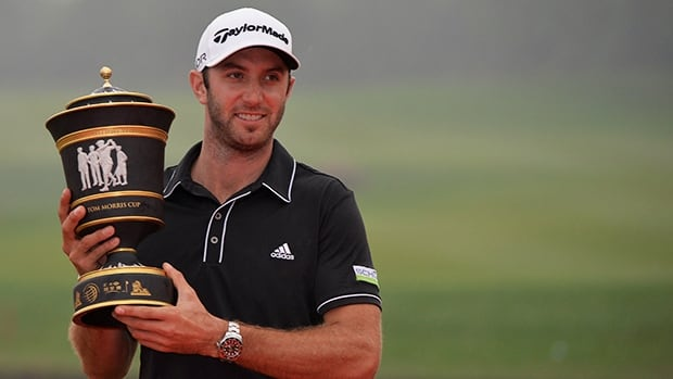 Dustin Johnson poses with the trophy after winning the HSBC Champions at the Shanghai Sheshan International Golf Club on November 3, 2013.