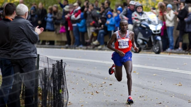 Geoffrey Mutai's time of 2 hours, 8 minutes, 24 seconds was well off his course record of 2:05:06 set in nearly perfect conditions two years ago. He's the first man to repeat in New York since Kenya's John Kagwe in 1997-98.