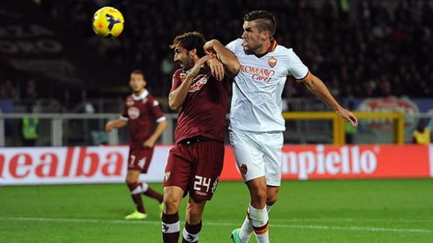 Emiliano Moretti of Torino, left, clashes with Kevin Strootman of Roma during the match at Stadio Olimpico di Torino on November 3, 2013 in Turin, Italy.