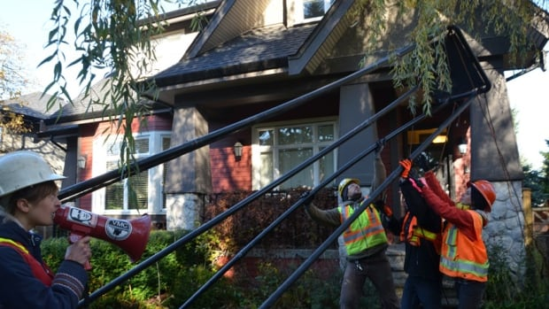 Anti-fracking activists erected a fake rig outside B.C. Premier Christy Clark's house Sunday.