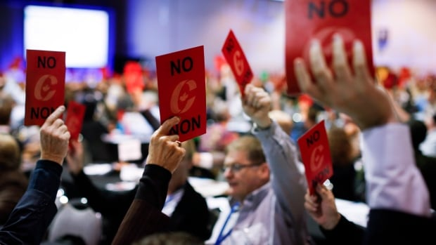 Delegates vote on a resolution at the Conservative Party convention in Calgary, on Saturday.
