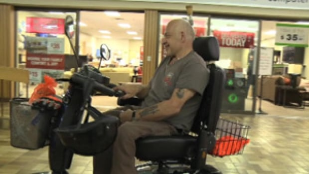 Fergus Brown takes a spin around a mall in Marystown in his new mobility scooter.