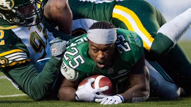 Roughriders running back Chris Garrett loses his helmet after being hit by Eskimos defensive end Justin Capicciotti on Saturday. Garrett is the CFL offensive player of the week, rushing for 152 yards and a touchdown on the final week of the regular season.