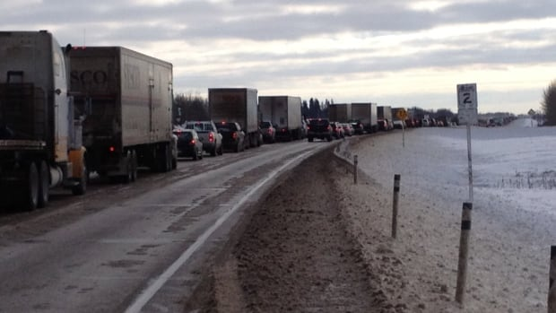 Vehicles line up on the QEII Monday afternoon, approaching a four-vehicle crash that involved a semi. No one was hurt. RCMP asked drivers to use caution due to slippery sections.