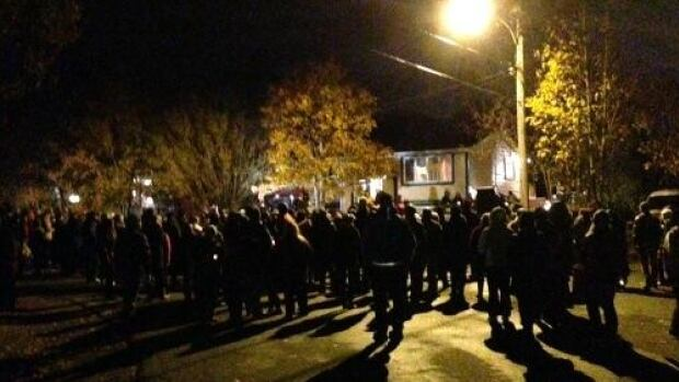 Hundreds of people gather outside the Mercer family home in C.B.S. to take part in a prayer vigil for Riley Mercer, 15.