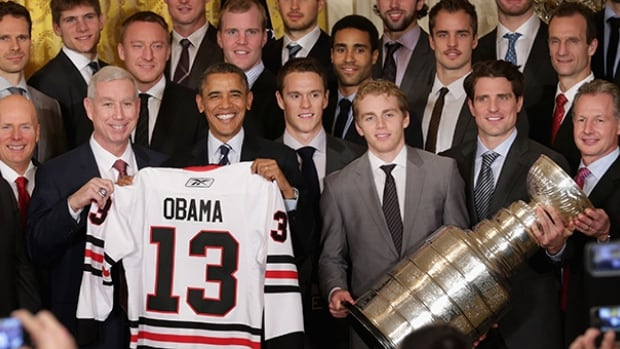 U.S. President Barack Obama poses with the 2013 Stanley Cup champion Chicago Blackhawks in the East Room of the White House November 4, 2013 in Washington, DC.
