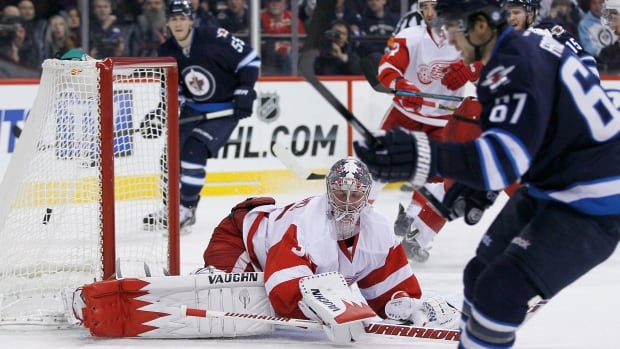 The Winnipeg Jets' Michael Frolik scores on Detroit Red Wings goalie Jimmy Howard during the second period on Monday, Nov. 4, at the MTS Centre. The Jets won 4-2.
