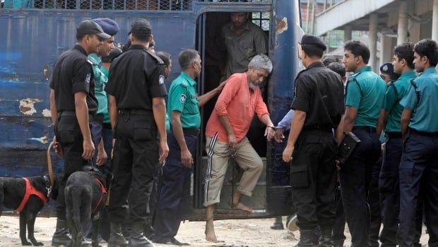 Handcuffed border guards arrived at a special court in Dhaka, Bangladesh on Tuesday. The court delivered verdicts involving a 2009 mutiny at the headquarters of the country's border guards.