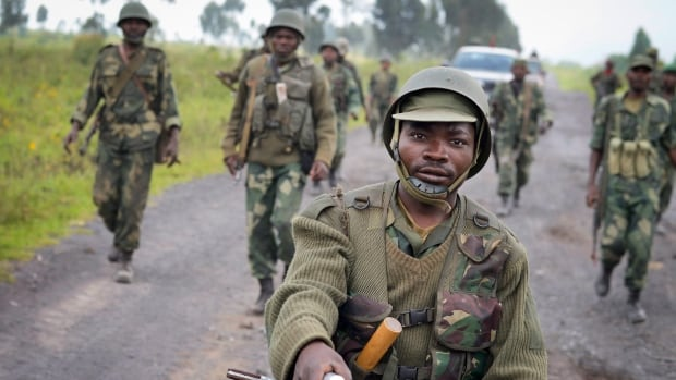 Congolese army soldiers march into Kibumba town after recapturing it from M23 rebels last month, one of several rapid victories for the military.