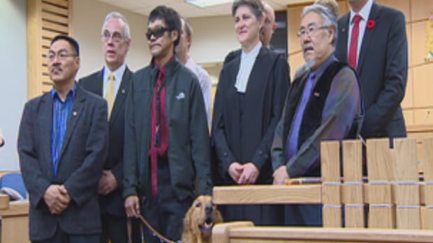 Noah Papatsie, shown here in dark glasses, was sworn in as Iqaluit's newest city councillor at a ceremony at the Nunavut Court of Justice yesterday.