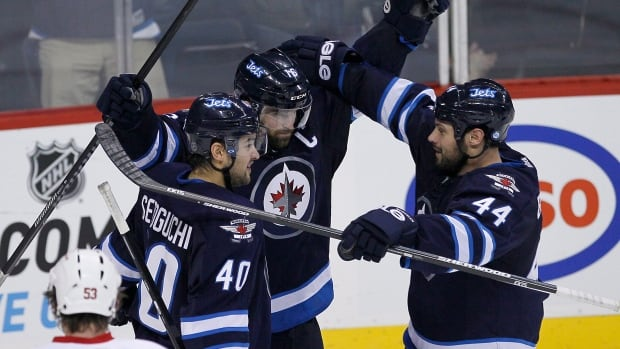 Winnipeg Jets' Devin Setoguchi, Andrew Ladd (centre) and Zach Bogosian (44) celebrate Ladd's goal against the Detroit Red Wings during third period of their game in Winnipeg on Nov. 4.