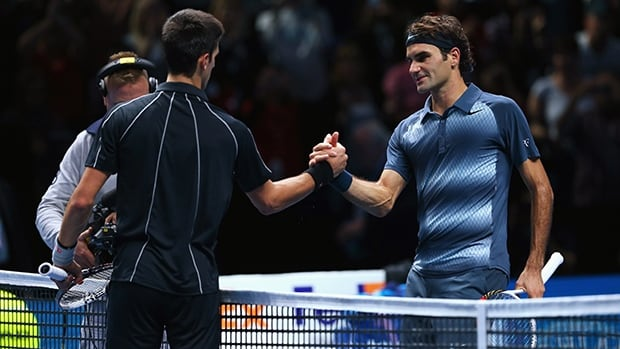 Roger Federer of Switzerland congratulates Novak Djokovic of Serbia after their men's singles match during day two of the ATP World Tour Finals.