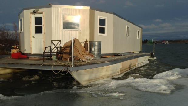 Randy Sibbeston says he won't move his Yellowknife houseboat, which is currently moored near Rotary Park in Old Town,  despite an order by the N.W.T. government. He's asking the government to pay him $1,000 a day in damages for lost earnings while the case is before the courts.