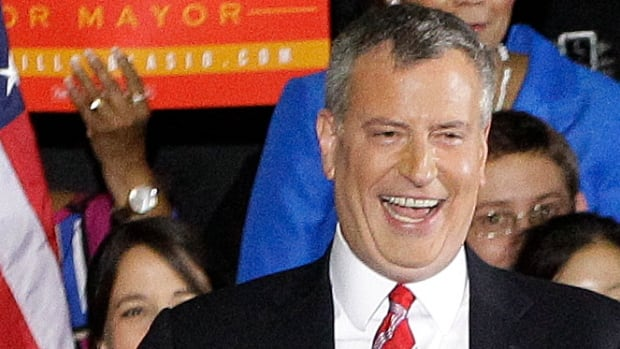 Democratic mayor-elect Bill de Blasio reacts on stage in the Brooklyn borough of New York Tuesday after he was elected the first Democratic mayor of New York City in 20 years.
