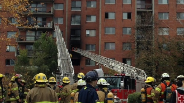 Firefighters rescued tenants from upper-level apartments after fire broke out in the building early Wednesday afternoon.